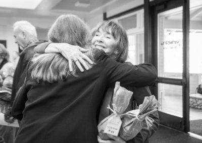 Carol hugging